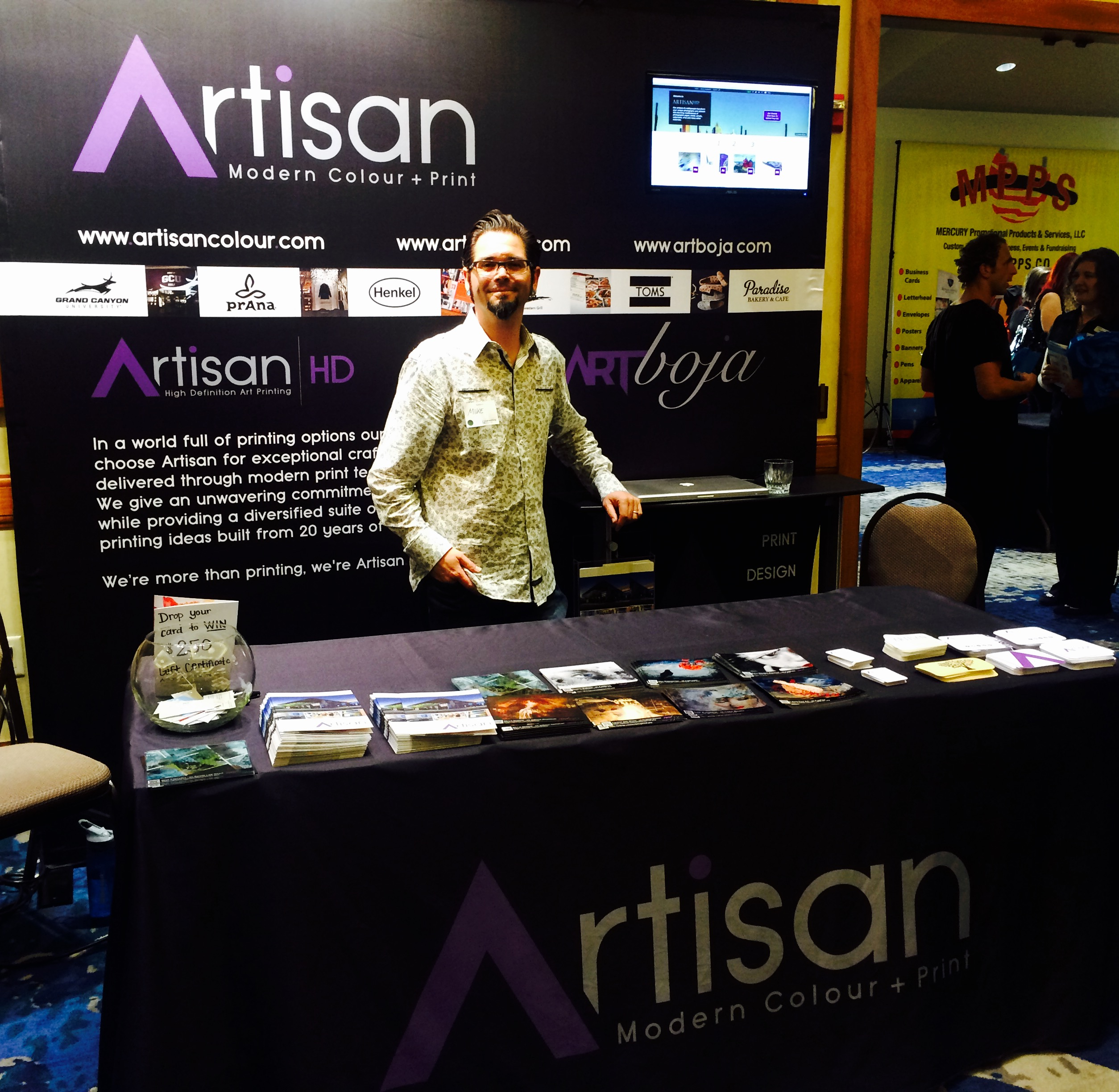 ArtisanHD showing off new booth back-drop at Phoenix Networking Signature Event