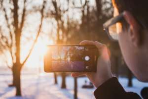 Smartphone vs. Digital Camera taking a picture with a smartphone web